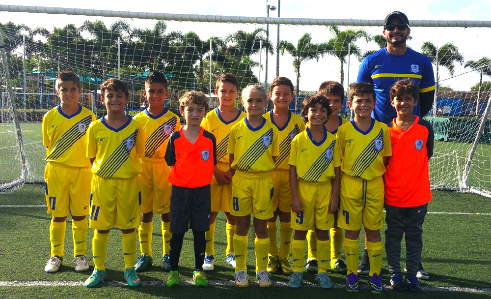 U9 White Coach Kevin Piraquive
